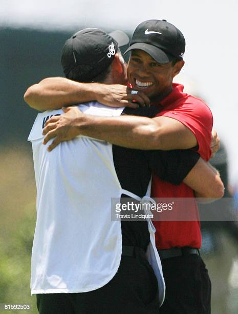 Tiger Woods hugs his caddie Stave Williams after winning the playoff round of the 108th US Open at the Torrey Pines Golf Course on June 16 2008 in...