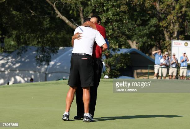Tiger Woods hugs his caddie Steve Williams after his twostroke victory during the final round of the 89th PGA Championship at the Southern Hills...