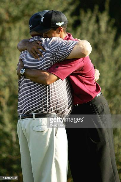 Tiger Woods hugs his father, Earl Woods, after the final round of the Target World Challenge on December 12, 2004 at Sherwood Country Club in...