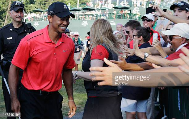 Tiger Woods is congratulated by fans after winning the ATT National at Congressional Country Club on July 1 2012 in Bethesda Maryland