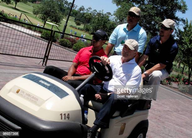 Tiger Woods is driven off the golf course to the clubhouse by Joe Corless, the head of PGA TOUR security after Tiger withdraws on the seventh hole...