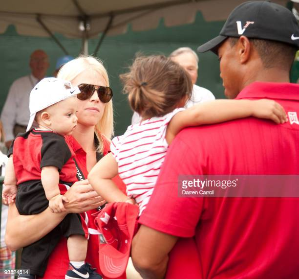 Tiger Woods is greeted by his son Charlie Woods wife Elin Woods and daughter Sam Woods after the final round of the 2009 ATT National hosted by Tiger...