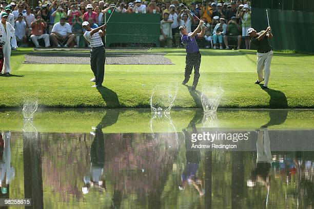 Tiger Woods, Jim Furyk and Fred Couples skip shots across the pond in front of the 16th green during a practice round prior to the 2010 Masters...