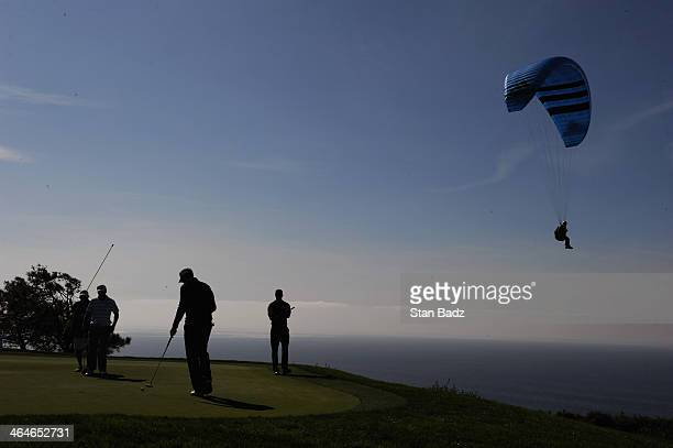 Tiger Woods Jimmy Walker and Jordan Spieth play on the 4th green during the first round of the Farmers Insurance Open on Torrey Pines South on...