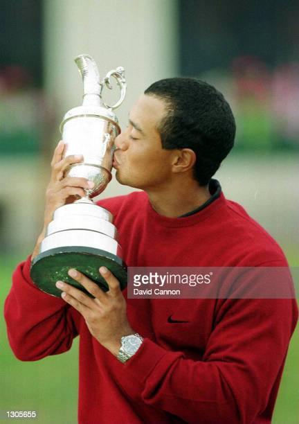 Tiger Woods kisses his trophy after winning the British Open Championships at the Old Course St Andrews Scotland July 23 2000