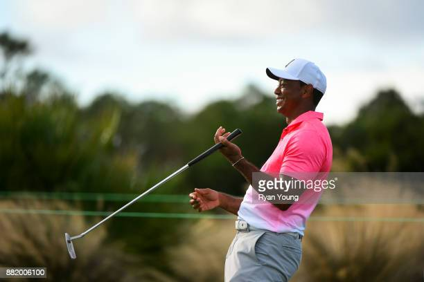 Tiger Woods laughs on the putting green during practice for the Hero World Challenge at Albany course on November 29 2017 in Nassau Bahamas