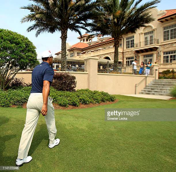 Tiger Woods leaves the course after withdrawing after playing the ninth hole during the first round of THE PLAYERS Championship held at THE PLAYERS...