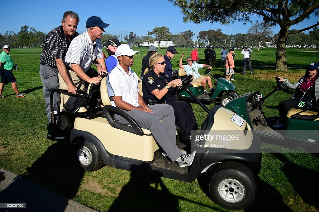 Tiger Woods leaves the course after withdrawing from the Farmers Insurance Open due to injury at Torrey Pines Golf Course on February 5, 2015 in La Jolla, California.