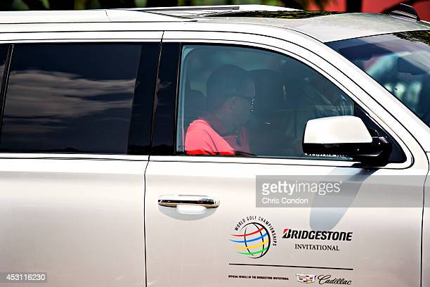 Tiger Woods leaves the course after withdrawing on the ninth hole during the final round of the World Golf Championships-Bridgestone Invitational at...
