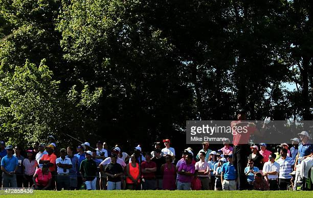 Tiger Woods lets go of his driver as he plays his shot from the seventh tee during the final round of THE PLAYERS Championship at the TPC Sawgrass...