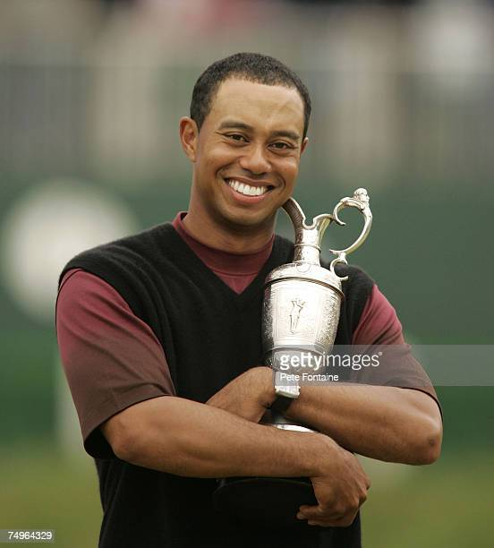 Tiger Woods lifts the Claret Jug after winning the 2005 British Open Golf Championship at the Royal and Ancient Golf Club in St Andrews Scotland on...