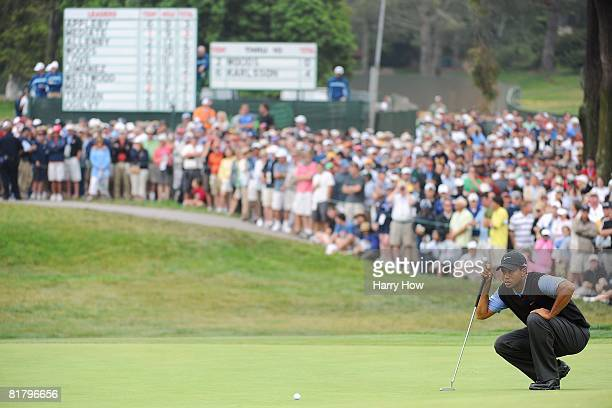 Tiger Woods lines up a putt in front of a gallery during the third round of the 108th US Open at the Torrey Pines Golf Course on June 14 2008 in San...