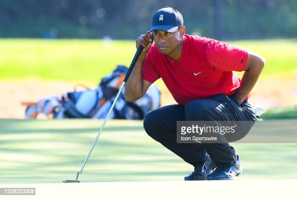 Tiger Woods lines up a putt on 7th hole during the final round of The Genesis Invitational golf tournament at the Riviera Country Club in Pacific...