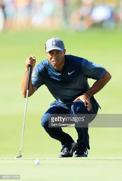 Tiger Woods lines up a putt on the 18th during the first round of the Honda Classic at PGA National Resort and Spa on February 22 2018 in Palm Beach...