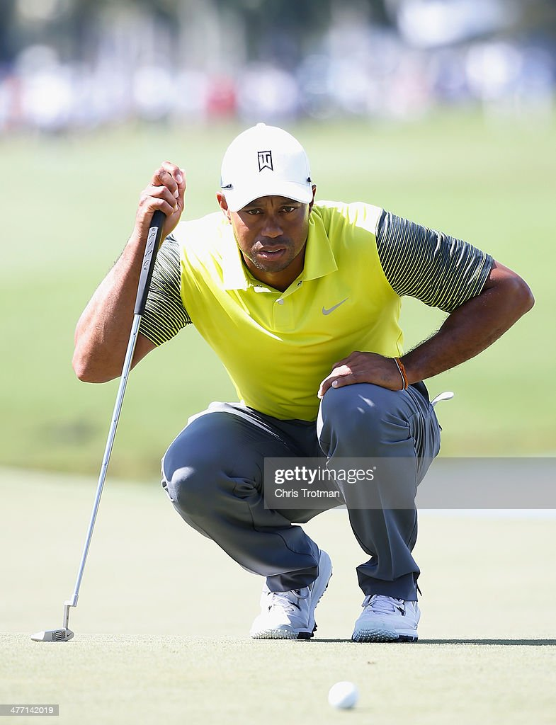 Tiger Woods lines up a putt on the 18th green during the second round of the World Golf Championships-Cadillac Championship at Trump National Doral on March 7, 2014 in Doral, Florida.