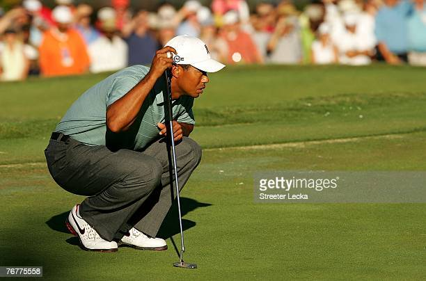 Tiger Woods lines up a putt on the 18th hole during the third round of the TOUR Championship the final event of the new PGA TOUR Playoffs for the...