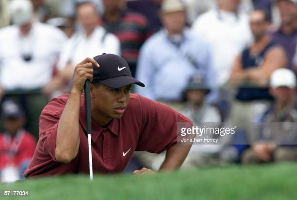 Tiger Woods lines up a putt on the first green during the final round of the 100th US Open at Pebble Beach on June 18,2000 in Monterey, California.