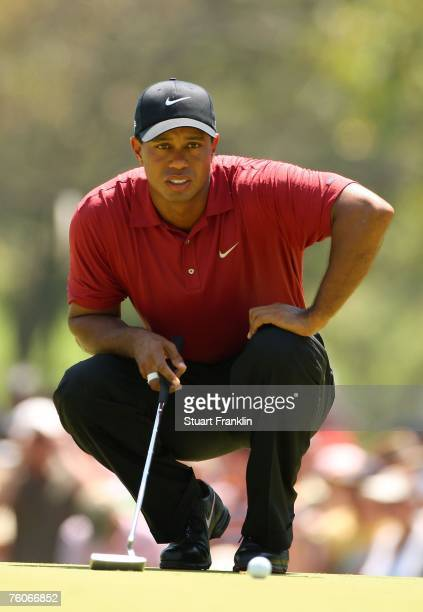 Tiger Woods lines up a putt on the first green during the final round of the 89th PGA Championship at the Southern Hills Country Club on August 12...