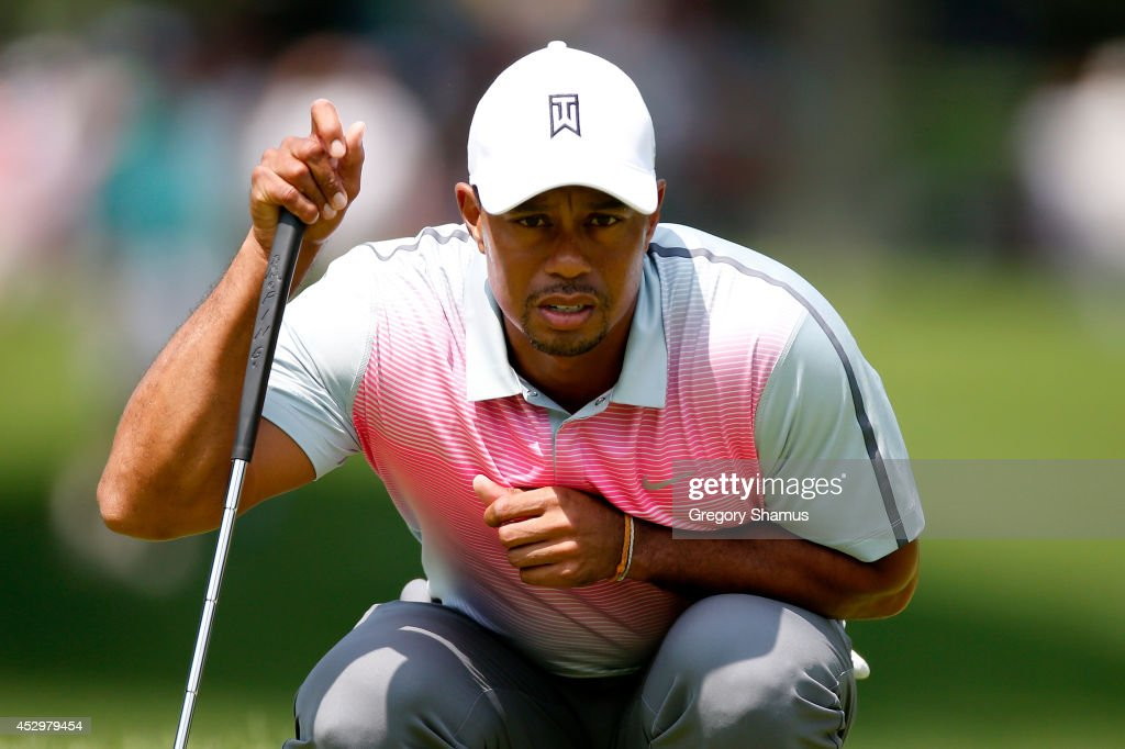 Tiger Woods lines up a putt on the first green during the first round of the World Golf Championships-Bridgestone Invitational at Firestone Country Club South Course on July 31, 2014 in Akron, Ohio.