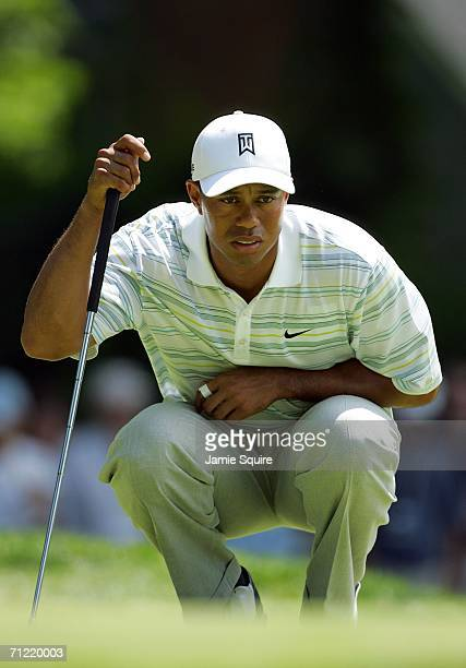 Tiger Woods lines up a putt on the fourth hole during the second round of the 2006 US Open Championship at Winged Foot Golf Club on June 16, 2006 in...