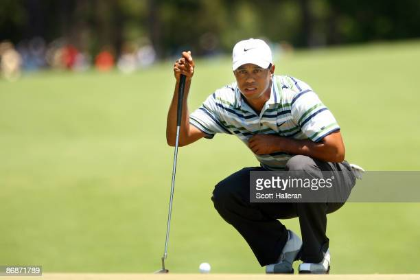 Tiger Woods lines up a putt on the second green during the third round of THE PLAYERS Championship on THE PLAYERS Stadium Course at TPC Sawgrass on...