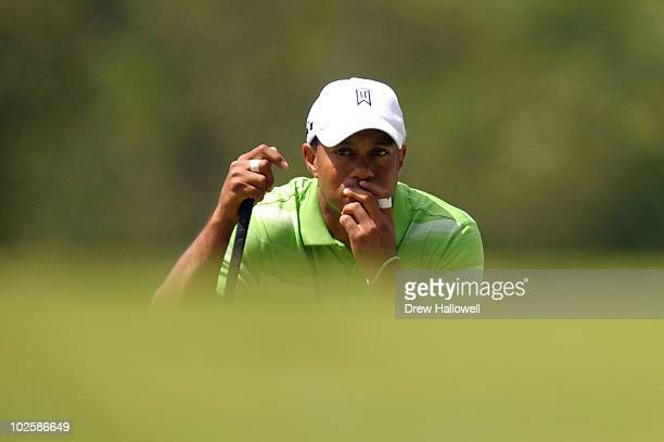 Tiger Woods lines up a putt on the second hole during the second round of the AT&T National at Aronimink Golf Club on July 2, 2010 in Newtown Square,...