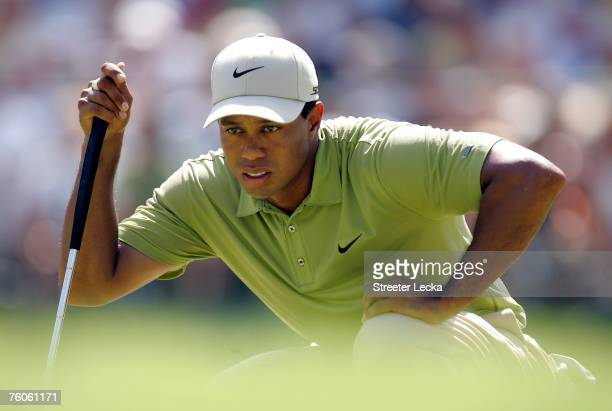 Tiger Woods lines up a putt on the sixth green during the third round of the 89th PGA Championship at the Southern Hills Country Club on August 11...