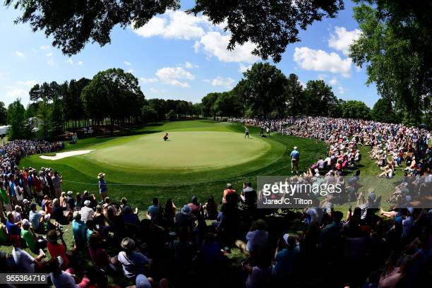 Tiger Woods lines up his birdie putt on the second green during the final round of the 2018 Wells Fargo Championship at Quail Hollow Club on May 6...