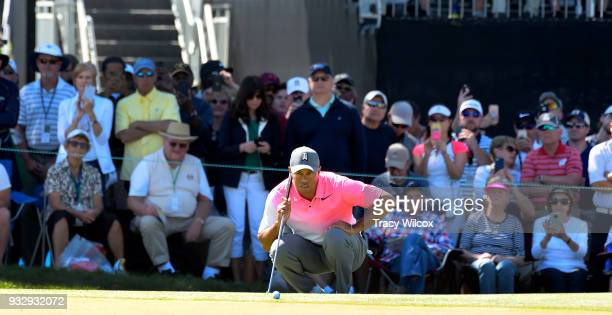 Tiger Woods lines up his putt at hole No 9 during the second round of the Arnold Palmer Invitational presented by MasterCard at Bay Hill Club and...