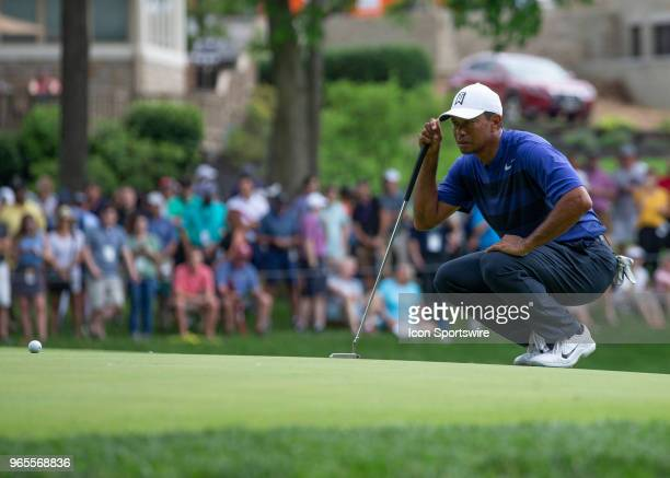 Tiger Woods lines up his putt during the second round of the Memorial Tournament at Muirfield Village Golf Club in Dublin Ohio on June 01 2018