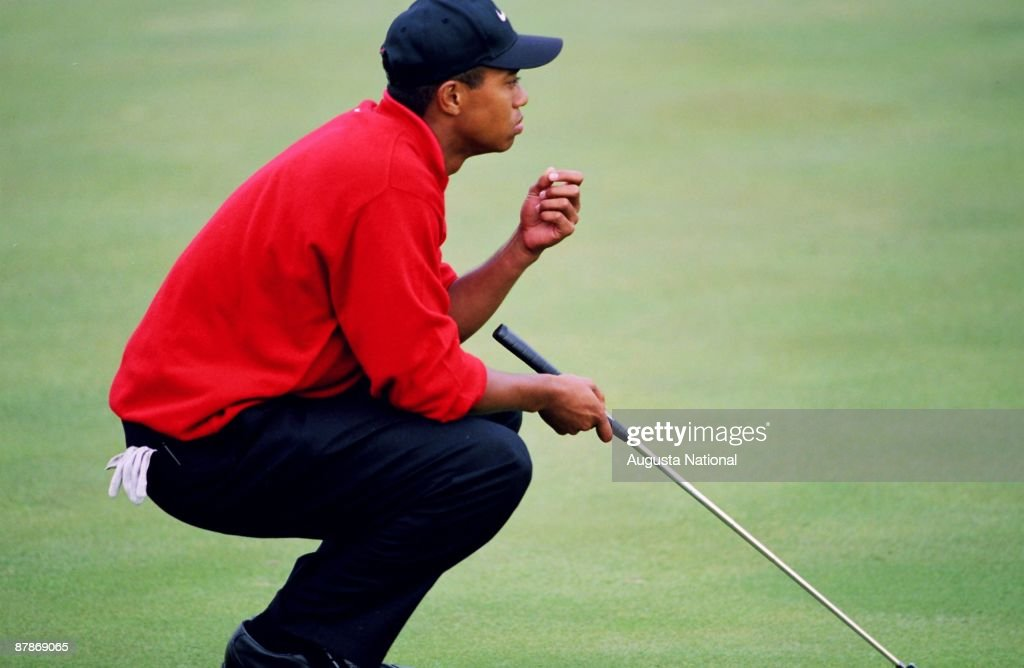 Tiger Woods lines up his putt for the win on the 18th hole during the 1997 Masters Tournament at Augusta National Golf Club on April 13, 1997 in Augusta, Georgia.