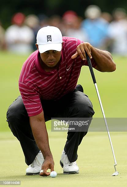 Tiger Woods lines up his putt on the 10th green during the first round of the Deutsche Bank Championship at TPC Boston on September 3, 2010 in...