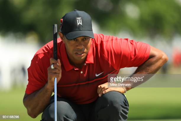 Tiger Woods lines up his putt on the fourth green during the final round of the Honda Classic at PGA National Resort and Spa on February 25 2018 in...