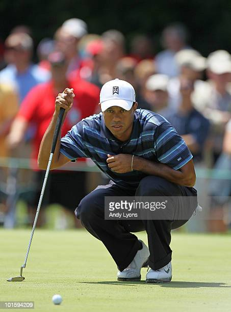 Tiger Woods lines up his putt on the second hole during the first round of The Memorial Tournament presented by Morgan Stanley at Muirfield Village...