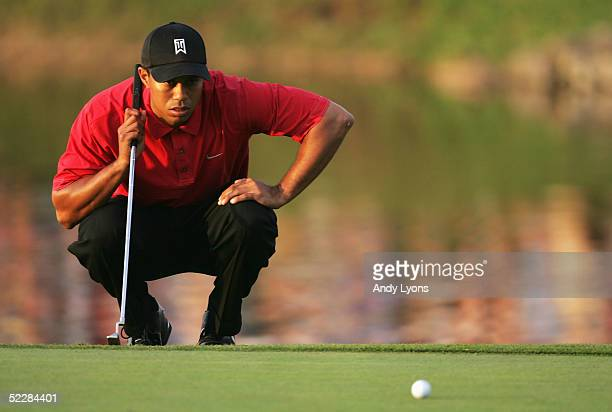 Tiger Woods lines up the winning putt on the 18th green of the Ford Championship at Doral on March 6, 2005 at the Doral Golf Resort and Spa in Miami,...