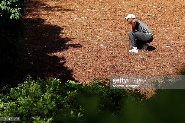 Tiger Woods looks at a shot after taking a drop in the rough on the second hole during the first round of the 2012 Masters Tournament at Augusta...
