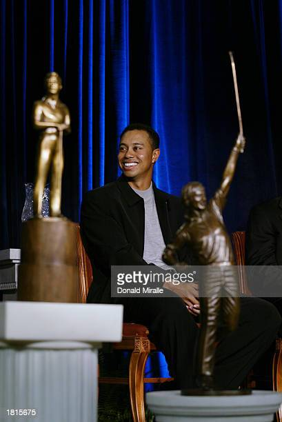 Tiger Woods looks on amidst Arnold Palmer Jack Nicklaus and Byron Nelson Awards Trophies all of which he won during the PGA Awards Ceremony for 2002...