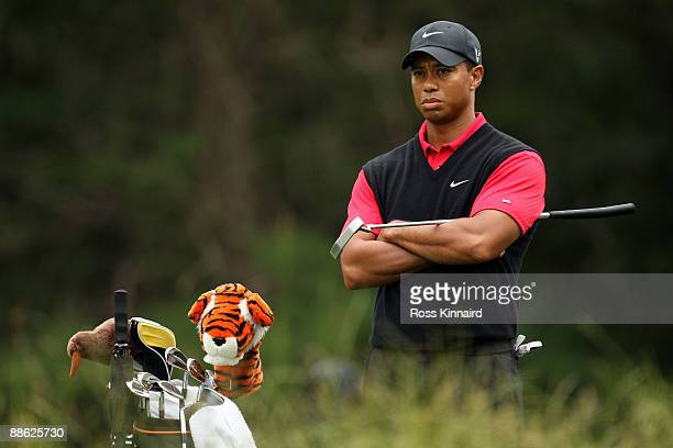 Tiger Woods looks on from the 14th tee during the continuation of the final round of the 109th US Open on the Black Course at Bethpage State Park on...