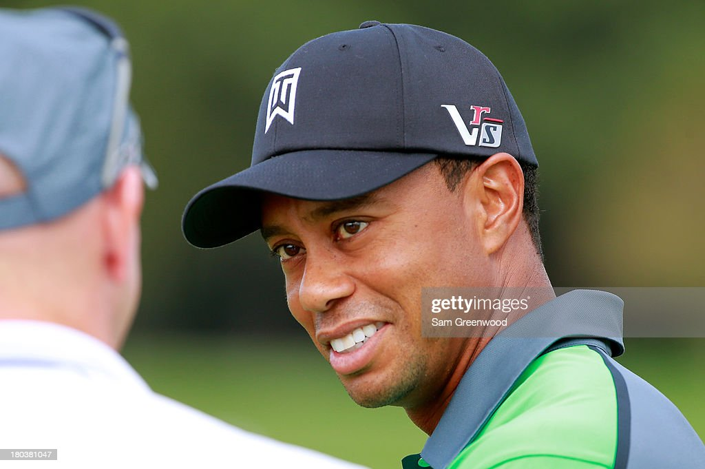 Tiger Woods looks on from the practice range prior to the First Round of the BMW Championship at Conway Farms Golf Club on September 12, 2013 in Lake Forest, Illinois.