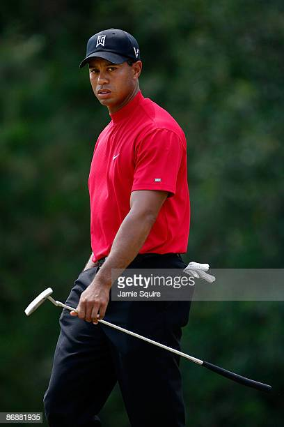 Tiger Woods looks on from the second hole green during the final round of THE PLAYERS Championship on THE PLAYERS Stadium Course at TPC Sawgrass on...