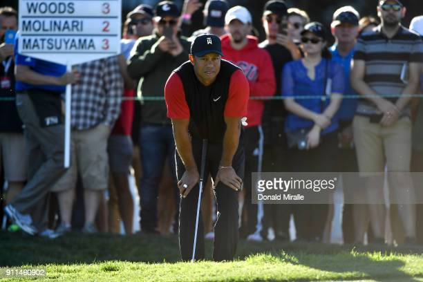 Tiger Woods looks on on the 11th green during the final round of the Farmers Insurance Open at Torrey Pines South on January 28 2018 in San Diego...