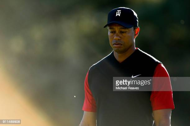 Tiger Woods looks on on the 11th hole during the final round of the Farmers Insurance Open at Torrey Pines South on January 28 2018 in San Diego...