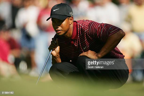 Tiger Woods looks over a putt during the final round of PGA Tour Championship at East Lake Golf Club on November 7 2004 in Atlanta Georgia