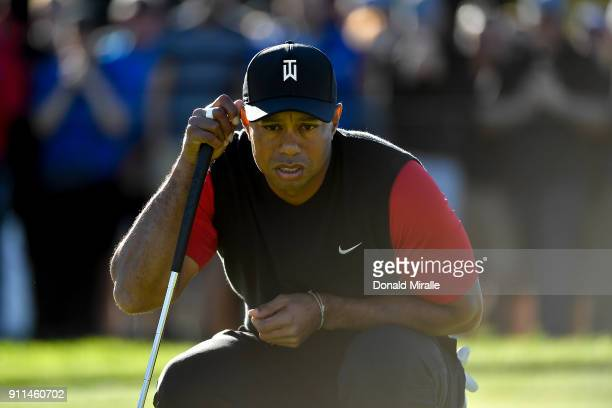 Tiger Woods looks over a putt on the 11th green during the final round of the Farmers Insurance Open at Torrey Pines South on January 28 2018 in San...