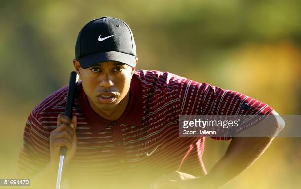Tiger Woods looks over a putt on the 12th green during the final round of PGA Tour Championship at East Lake Golf Club on November 7 2004 in Atlanta...