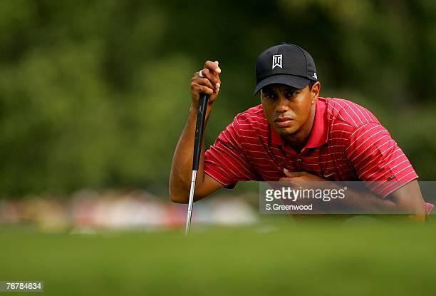 Tiger Woods looks over a putt on the 12th hole during the final round of the TOUR Championship, the final event of the new PGA TOUR Playoffs for the...