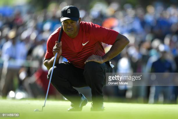 Tiger Woods looks over a putt on the 15th green during the final round of the Farmers Insurance Open at Torrey Pines South on January 28 2018 in San...