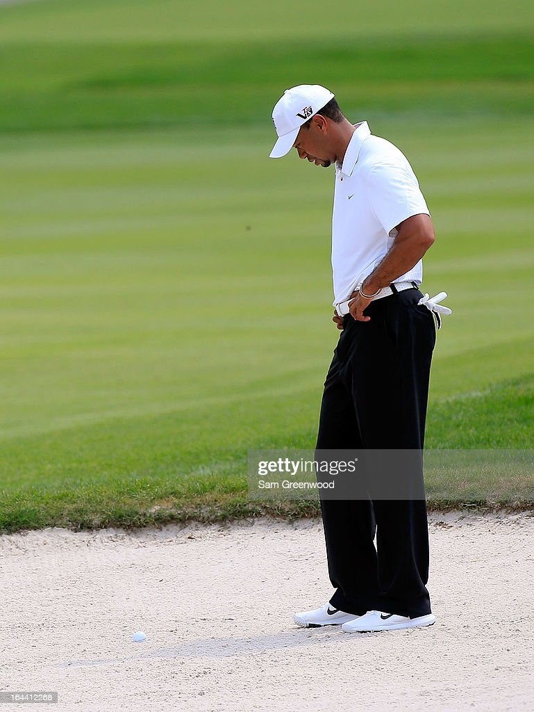 Tiger Woods looks over a shot on the 4th hole during the third round of the Arnold Palmer Invitational presented by MasterCard at the Bay Hill Club and Lodge on March 23, 2013 in Orlando, Florida.