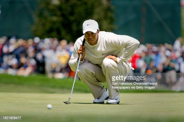 Tiger Woods looks over his birdie putt, which he made on the par-5 6th hole, during 3rd round action of the 2010 US Open Golf tournament at Pebble...