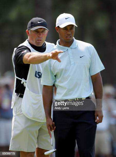 Tiger Woods looks over the eighth green with his caddie Steve Williams during round three of the U.S. Open on Pinehurst No. 2 at the Pinehurst Resort...